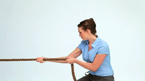 Young businesswoman pulling a rope stock video
