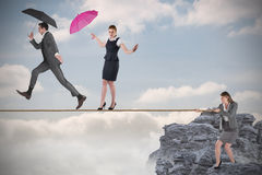 Young businesswoman pulling a tightrope for business people Stock Photos