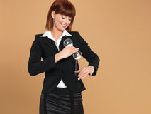young businesswoman puring sand from hourglass Stock Image
