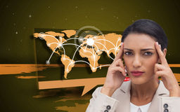 Young businesswoman putting her fingers on her temples Royalty Free Stock Images