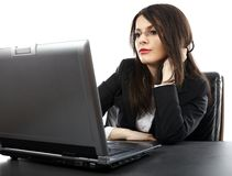 Young businesswoman reading from her laptop Royalty Free Stock Photography
