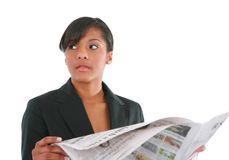 Young Businesswoman Reading Newspaper Royalty Free Stock Photo