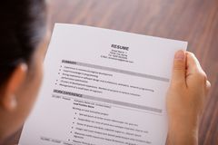Young businesswoman reading resume royalty free stock photo