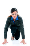 Young Businesswoman Ready To Run. Portrait of an attractive young woman in position ready to run, over white background Royalty Free Stock Photos