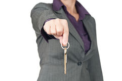 The young businesswoman (real estate agent) hold the key in the Royalty Free Stock Images