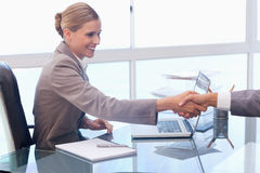 Young businesswoman receiving a customer Royalty Free Stock Photo