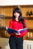 Young businesswoman in red blouse with a folder of documents Royalty Free Stock Photography