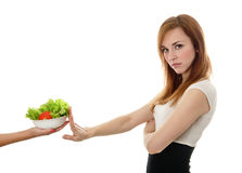 Young businesswoman refuses salad Royalty Free Stock Images