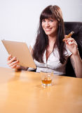 Young businesswoman relaxing in her office Stock Images