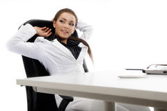 Young businesswoman relaxing. In the office stock photography