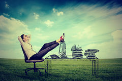 Young businesswoman relaxing sitting in the office royalty free stock images