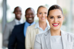 Young businesswoman in a row stock photography