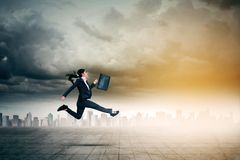 Young businesswoman carrying a briefcase Stock Images