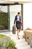 Young businesswoman rushing luggage going busy traveling Stock Images