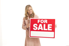 Young businesswoman with for sale sign Stock Photo