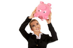 Young businesswoman saving money in piggybank.  Stock Images