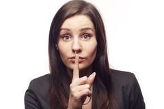 Young businesswoman saying shh Royalty Free Stock Images