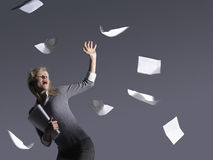 Young Businesswoman With Scattering Papers Stock Image