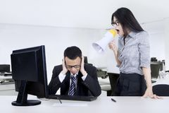 Businesswoman scolds her worker Stock Image