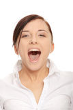 Young businesswoman screaming Stock Images