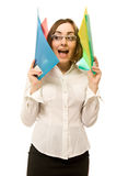 Young businesswoman screaming. Young businesswoman holding colorful folders stock photos