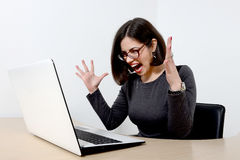 Young businesswoman screaming at laptop Royalty Free Stock Photos