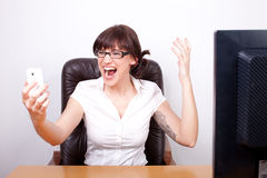 Young businesswoman screaming in rage Stock Photos