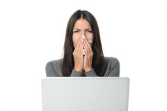 Young businesswoman with a seasonal cold and flu Royalty Free Stock Images