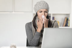 Young businesswoman with a seasonal cold and flu stock image