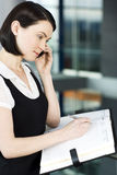 Young businesswoman or secretary making an appointment in a diary Stock Image