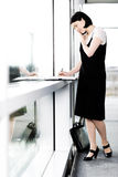 Young businesswoman or secretary making an appointment in a diary Stock Images