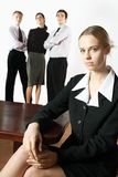 Young businesswoman or secretary and three business persons stock photos