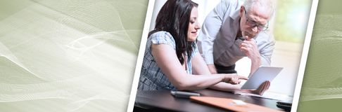 Young businesswoman and senior businessman working together, light effect. panoramic banner royalty free stock photo