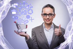 The young businesswoman with shopping cart Stock Photography