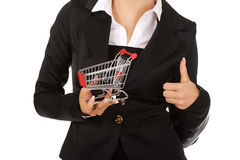Young businesswoman with shopping trolley.  Royalty Free Stock Image