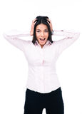 Young businesswoman shouting and covering her ears Stock Photo