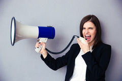 Young businesswoman shouting with megaphone Royalty Free Stock Photo