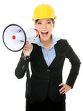 Young Businesswoman Shouting Into Megaphone. Portrait of young businesswoman shouting into megaphone isolated on white background Stock Image