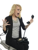 Young Businesswoman shouting over the phone Stock Images