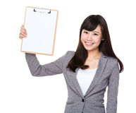 Young businesswoman show with blank page of clipboard. Isolated on white background Royalty Free Stock Photo