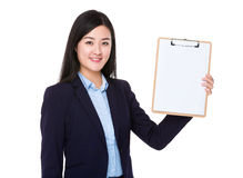 Young businesswoman show with clipboard Stock Photos