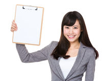 Young businesswoman show with clipboard Royalty Free Stock Photo