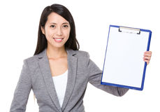 Young businesswoman show with clipboard Royalty Free Stock Image