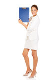 Young businesswoman show empty clipboard Stock Images