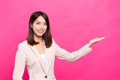 Young businesswoman showing advertisement space Royalty Free Stock Image