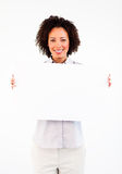 Young businesswoman showing big white card Royalty Free Stock Photography