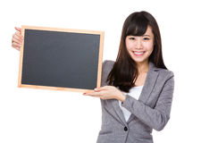 Young businesswoman showing the blank of chalkboard. Isolated on white background Stock Image