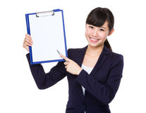 Young Businesswoman showing blank page of file board. On white background Stock Images
