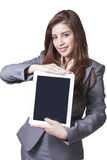 Young businesswoman showing digital tablet Stock Image