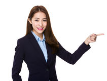 Young businesswoman showing finger point aside Royalty Free Stock Photo